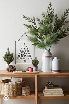 Give your entryway console some holiday cheer with pops of red & green decor. Up the excitement for Christmas Day with a hanging countdown calendar, a mix of faux greenery and vases add a sense of freshness and candles bring the festive ambience. #HearthAndHand