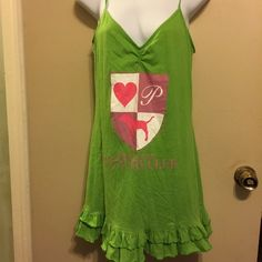 A pink sleep gown Has  meet me at the country club on front . Has emblem crest with heart , letter P and the pink dog , with a ruffle around bottom . PINK Victoria's Secret Tops