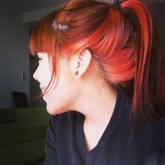 I like the color red of the bottom of her hair