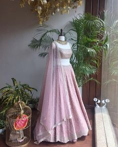 adds a dose to Fall festivities with these statement pieces. Indian Fashion Dresses, Indian Bridal Outfits, Indian Gowns Dresses, Dress Indian Style, Indian Designer Outfits, Unique Dresses, Sharara Designs, Lehenga Designs, Half Saree Designs