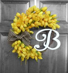 Bright, sunny yellow mini tulips surround this grapevine wreath in your choice of monogram and color of ribbon!  Several sizes and more tulip color choices available in my boutique!