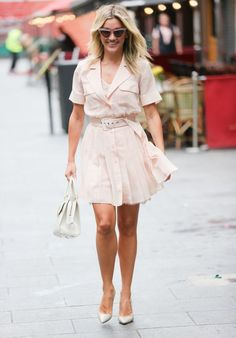 Ashley Roberts in a belted pleated mini dress paired with pumps | For more style inspiration visit 40plusstyle.com