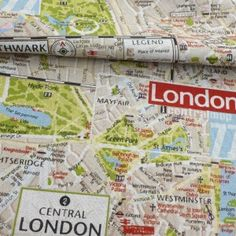 London Map Fabric.  I wished there was such a thing and lo and behold there is!  Now to get it and cut it and sew it into a skirt for YOU!