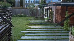 Bluestone terrace with grass growing - uneven edge to blur with the yard | Gardenista