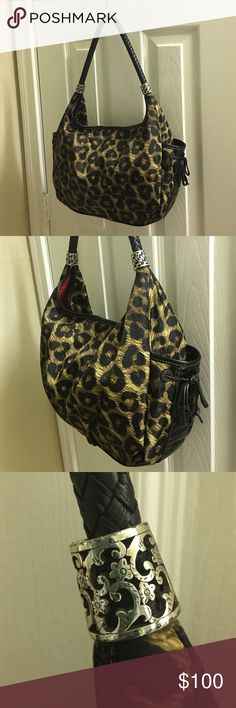 "Brighton Leopard Hobo Bag Brighton Leopard hobo bag.  Gently used, no stains.  Fabric bag with braided leather shoulder strap (17"" long) and patent leather trim and pebble grain leather base.  Two side slip pockets for cell phone or keys, three interior pockets, and interior magnetic closure.  Very minor tarnishing on silver ornamentation on shoulder strap. (See third photo). Accepting offers. Brighton Bags Hobos"