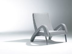 Oxoye, chair, design by Dzmitry Samal, 2012, Soca  Inspired by car style, particularly by the winds of retro cars through 30th-50th and features pure and dynamic shape.