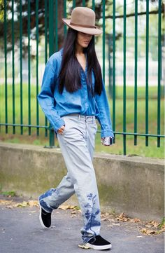 Gilda Ambrosio wearing acid wash boyfriend jeans and a chambray button up