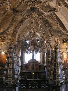 Sedlec Ossuary, Czech Republic: 'This eerie, thought-provoking place is not one you would want to be in after dark. You cannot miss the chandelier in the middle containing at least one of every bone in the human body.' Read more in Czech Republic: The Bradt Guide www.bradtguides.com