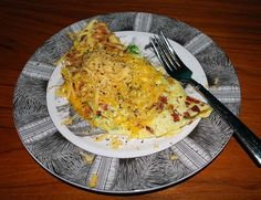 3 egg omelet w/ chopped broccoli, 4 slices bacon, grated sharp cheddar cheese