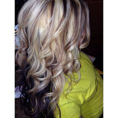 Blonde and brown highlights with a dark base.