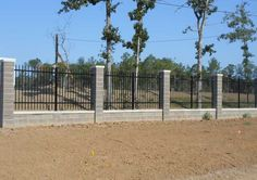 Wrought Iron Fence with Stone Columns. Use cement blocks for material, then cover with stone finish