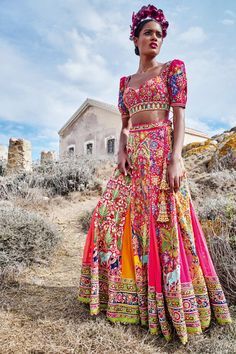 """""""Vrindavan: where Krishna is. A riot of multi-hued silk-thread embroidery anoints this multi-paneled skirt. From a collection inspired by the mythological tales of Krishna playing Holi in the city of Vrindaran."""""""