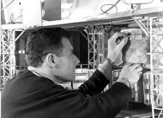 Derek Meddings touching up the Marineville buildings for Gerry Anderson's STINGRAY series.