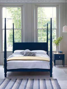 The Pinner Four Poster - a beautiful arts and crafts inspired four poster bed made from aged limed oak and finished in a contemporary palette.