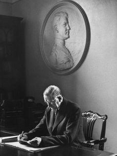Irish President Eamon de Valera Working under a Plaque of Irish Revolutionary Michael Collins Premium Photographic Print by Carl Mydans - by AllPosters.ie