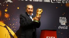 Alcides Ghiggia rise up the World Cup Trophy  as it did in 1950... The FIFA World Cup™ Trophy Tour by Coca-Cola in Uruguay on 16 January 2014.