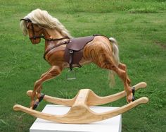Interior. Wooden Rocking Horse In Brown Finishing Has White Tails On Creamy Wooden Legs. Cool Wooden Rocking Horse With Attractive Design For Kids Toys