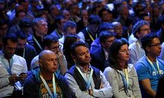 Attendees watch the opening keynote at the F8 conference.