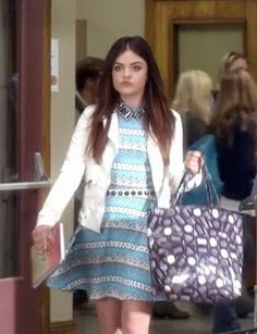 Gagging over Aria's blue patterned dress, chocolate tote and white jacket.