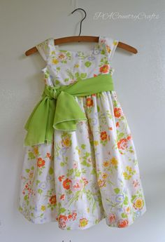 Gracie Dress Tutorial... 1950s style dress featuring a square neckline, vintage buttons, a sash in the front and made from a vintage sheet ~ PA Country Crafts