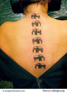 Elephant tattoos on a woman's spine -- neat idea!