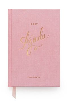 Take this pretty pink planner with you back to school.
