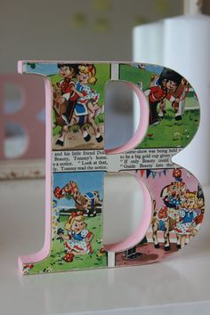 Handmade Vintage/Retro Storybook Wooden Letter for Childrens Room in Pink or Blue. Perfect unique and personal gift.