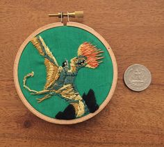 Embroidered Lessa and Ramoth from the book cover for Dragonflight, Anne McCaffrey's first Dragonriders of Pern novel.