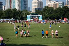 Fans walk toward the stage on a hot summer afternoon at Austin's summertime concert series, Blues on the Green, Zilker Park, Austin, Texas.
