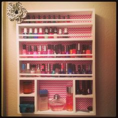 I like how there's room for perfume and other cute decorations. The print in the back is also so cute -Handmade nail polish rack! Love chevron, and the flowery touch :)