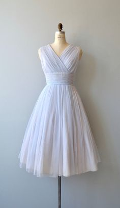 Vintage 1950s floaty pale periwinkle party dress in airy layered chiffon, with surplice bodice, fitted wrapped waist, full lining and metal zipper up the back. --- M E A S U R E M E N T S --- fits like: medium bust: 40 waist: 31 hip: free length: 47 brand/maker: n/a condition: excellent to ensure a good fit, please read the sizing guide: http://www.etsy.com/shop/DearGolden/policy ✩ layaway is available for this item ✩ more vintage dresses ✩ http:/&#...