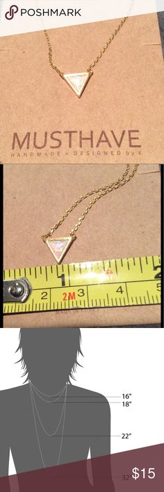 """Must Have Iridescent White Triangle Necklace Look at the second picture for the best view of the color. It is so pretty in person but the camera won't catch it.   Brand new.  16"""". Delicate. Retails for $27 Must Have Jewelry Necklaces"""