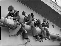 Four sailors sit astride one of the booms of the battleship HMS PRINCE OF WALES to clean and scrub it. Vintage Sailor, Vintage Men, Hms Prince Of Wales, Heavy Cruiser, Navy Uniforms, Navy Life, Navy Sailor, Royal Marines, Navy Ships