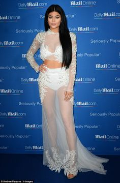 All that glitters: The reality star's sheer crop top and skirt was emblazoned with delicat...