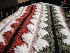 Apples and Pears is autumn colors of the Lion Brand Zig Zag Pattern. These colors make it gorgeous. - this is the pattern link; http://www.lionbrand.com/patterns/80208AD.html