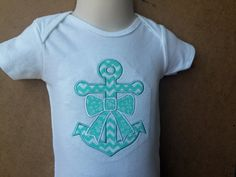 SIZE 12 Mos  This cute, summertime onesie has been appliqued with an anchor and bow design. The aqua prints are perfect for the summer and can be worn