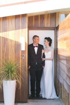 MID-CENTURY MODERN PALM SPRINGS WEDDING INSPIRATION  |  Photography by Jessica Claire  | Hotel Lautner |  Floral design by Oak & the Owl  | Kacee Geoffroy hair + makeup |  Rivini gown from Lovella Bridal  | Suit by Mr. Turk