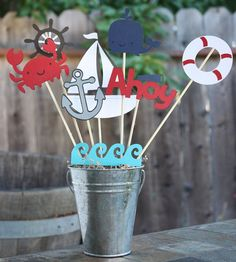 Nautical themed Birthday party centerpiece. Could also use glass bottles with sand and include generation pictures.