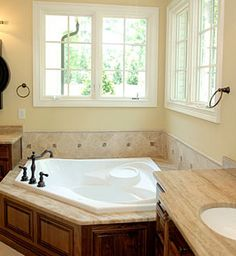 Wooden Wonders. Wood trim around the sink, cabinets, and tub walls creates an antique look.