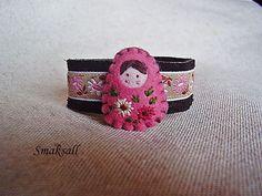 cuff bracelet with matroyshka adornment