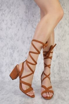 Wear this unique heels with anything in your closet! These heels are so unique in which feature a peep toe, a detailed strappy front straps along with a tie around lace up closure, a chunky heel, and a cushioned foot bed, Approximately a 3 1/2 chunky heel.