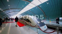 People walk near Maglev train on station in Shanghai Stock Footage, Shanghai Maglev Train, Train Station, Buses, Stock Video, Stock Footage, Planes, Trains, Ships, Walking
