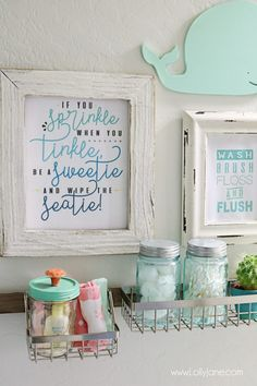 Cut kids bathroom! Refreshed for less than $100 and super organized... love the printable art, too!