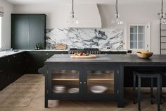 Combining our Spitalfields Cupboards painted in Plain English Army Camp Green with honed Arabescato marble and our Osea Island. Plain English Kitchen, English Kitchens, Glass Kitchen, Kitchen Dining, Reeded Glass, Kitchen Trends, Kitchen Ideas, Kitchens, Apartments