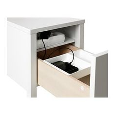 Love this nightstand, but I would get it in black. It has a hidden shelf and allows cords to hide in the back.