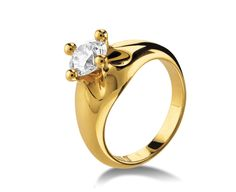 Corona solitaire ring in yellow gold with round brilliant cut diamond. Available in 0.30 ct.  Inspired by the crown and the flower, two enduring symbols of glory and celebration since ancient times.