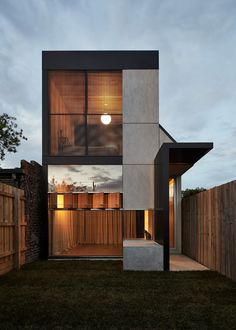 Completed in 2016 in Brunswick East, Australia. Images by Peter Bennetts. . In a row of workers' cottages, there is one Dark Horse – a handsome creature. The stepped parapet, centered window, sidelined door and entrance...