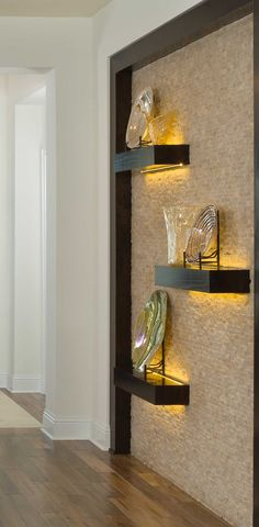 Lighted shelves can be done tastefully and add luxury to a home! See dedign ideas and more: http://www.arthurrutenberghomes.com/