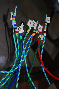 Fine motor skills: beads and pipe cleaners