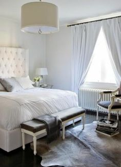 Master Bedroom. So bright. I love the bed and the cushioned headboard. The bench at the foot of the bed is a nice touch.